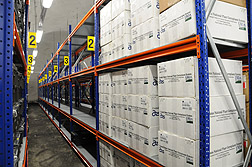Photo: Some of the boxes of seeds that ARS has sent to the Svalbard Global Seed Vault sitting on shelves beneath the permafrost.