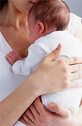 Photo: Woman holding baby.