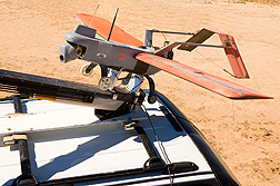 Photo: An unmanned aerial vehicle being readied to launch from a catapult to survey rangeland. Link to photo information