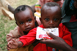Photo: Two malnourished children receiving food assistance in Ethiopia.
