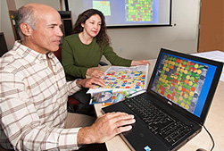 Photo: ARS soil scientist Jorge Delgado (far left) and Ana Karina Saavedra Rivera from Bolivia examine a Nitrogen Index map of a crop field. Link to photo information