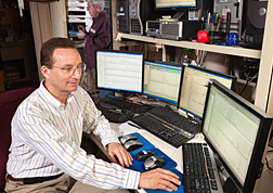Photo: ARS chemist Craig Byrdwell studies food composition data on computer screens. Link to photo information
