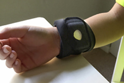 Wireless sensor worn on wrist of child to measure emotional fluctuations through monitoring sweat gland activity.  Link to photo information